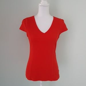 Red V-neck top from Anthropologie